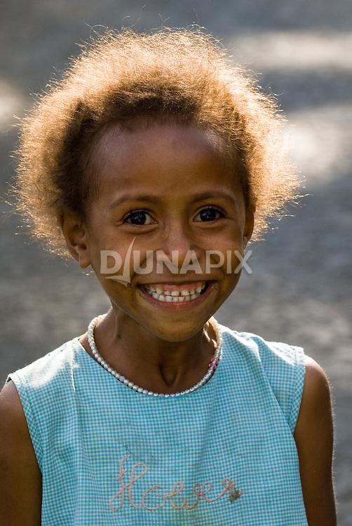 Giggling girl near Bajawa, Flores