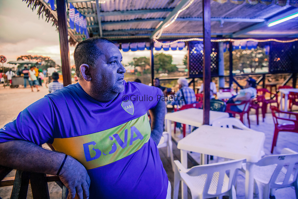 Martin is from Atalaia do Norte, Amazonas. For the past 15 years He has lived with his Colombian wife in Tabatinga, Brazil. Together they manage this bar in Leticia, on the Colombian side of the border. They met here in Leticia.