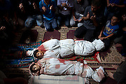 Family members pray in the mosque in Sajeria , Gaza by the  bodies of Amir,15, Mustafa Arief and Mohammed during their funeral in Sajeria ,Gaza July 9,2014. The brothers were today  killed together  near their home allegedly by an Israeli drone in Sajeria, Gaza .(Photo by Heidi Levine/Sipa Press).