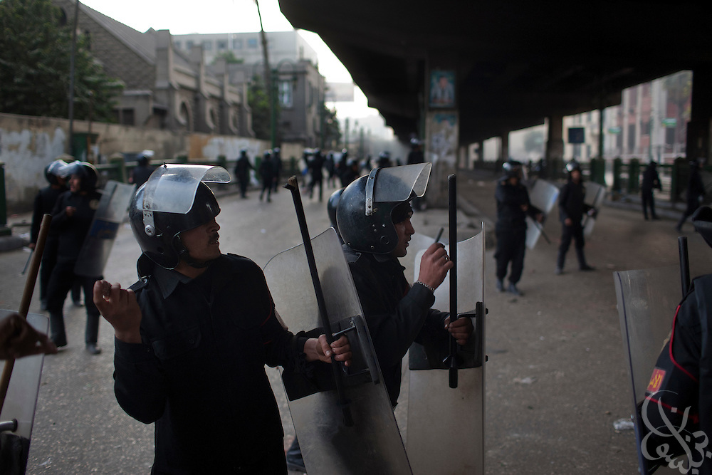 Egyptian riot police throw stones back at protestors during continuing January 26, 2011 demonstrations in downtown Cairo, Egypt. A series of unprecedented demonstrations have broken out across Egypt for the past two days, inspired by the revolution in Tunisia, and intended to spark a similar movement in Egypt. (Photo by Scott Nelson)
