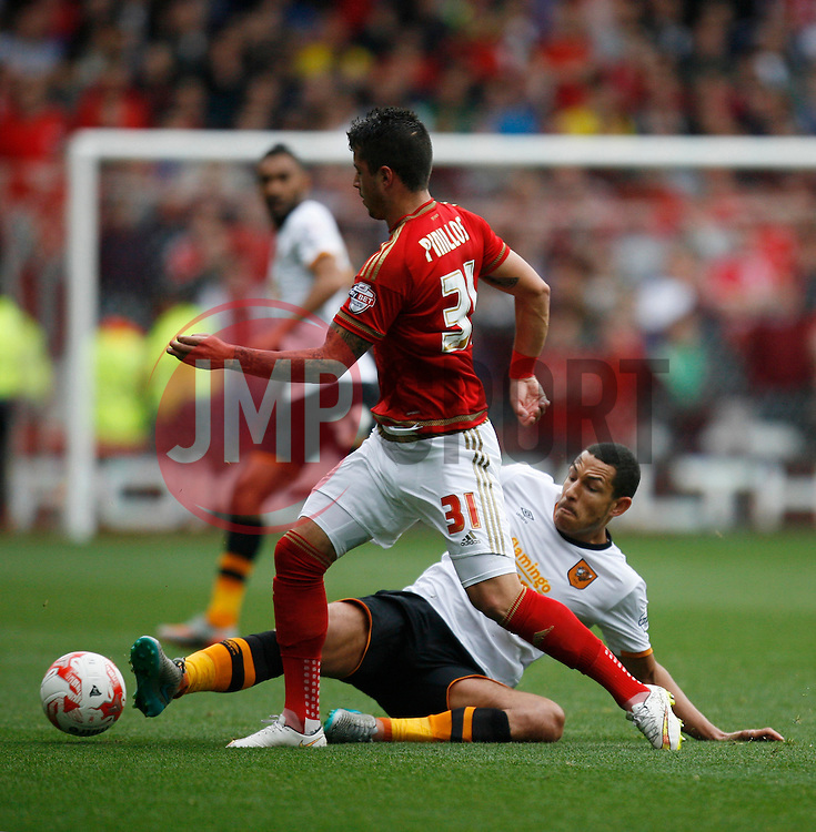 Jake Livermore of Hull City tackles Daniel Pinillos of Nottingham Forest (L) - Mandatory byline: Jack Phillips / JMP - 07966386802 - 3/10/2015 - FOOTBALL - The City Ground - Nottingham, Nottinghamshire - Nottingham Forest v Hull City - Sky Bet Championship