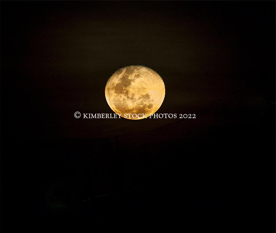 A beautiful orange moon rises over Roebuck Bay in Broome.