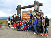 Bellaire High School IB/AP geography and environmental students and Pin Oak Middle School students at the entrance to Grand Tetons National Park, their classroom for the day.