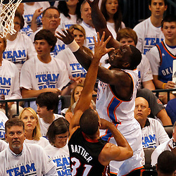 Jun 14, 2012; Oklahoma City, OK, USA;  Oklahoma City Thunder center Kendrick Perkins (5) drives to the basket against Miami Heat small forward Shane Battier (31) during the first quarter of game two in the 2012 NBA Finals at Chesapeake Energy Arena. Mandatory Credit: Derick E. Hingle-US PRESSWIRE