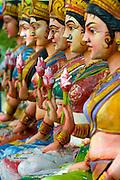 Painted figures at a shrine near Neyveli, Tamil Nadu, South India. The main shrine is dedicated to Hanuman. The roadside shrine has many painted Gods and idols from the Hindu pantheon.