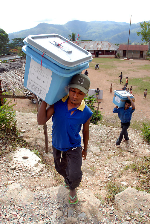 Carlito Piedade and Antonio Honoritas carry Ballot Boxes to the Polling place at Samelete where the local population will turn out to cast their vote on Timor-Leste's June 30 Parliamentary Elections. The ballot boxes and other materials for voting were loaded onto trucks and transported from Gleno.