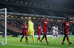 Swansea City's Tammy Abraham (centre) celebrates after scoring their third goal during the Carabao Cup, Second Round match at Stadium MK, Milton Keynes.