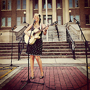 Gary Cosby Jr.  iPhone photographs<br /> A singer performs on the square at the Limestone County Courthouse.