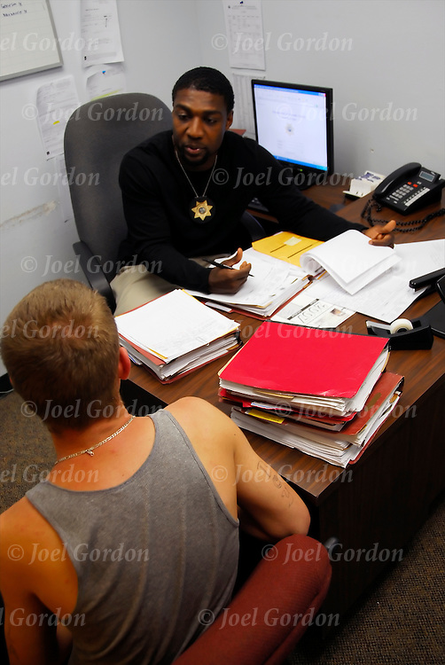 Juvenile Probation Officer interviewing client in either office or in the Juvenile Detention Center for purpose of obtaining contact information and reviewing probationary status.<br />