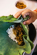 Chef Luu Meng preparing dry beef curry in lotus leaf (sakhkor saraman) in the kitchen of his restaurant Malis, Phnom Penh