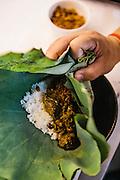 Chef Luu Meng preparing dry beef curry in lotus leaf (sakhkor saraman) in the kitchen of his restaurant Malis, Phnom Penh