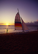 Couple with sailboat, Kaanapali, Maui, Hawaii<br />