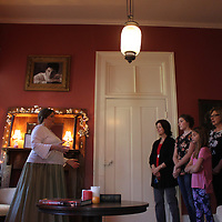 Caroline Pugh, middle, gives a tour of one of the rooms at Mon Chalet.