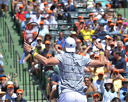 April 1, 2018 - Miami, FL, United States - KEY BISCAYNE, FL - APRIL 1: John Isner (USA) pumps up the crowd during his final round match at the Miami Open held at the Tennis Center at Crandon Park on April 1, 2018.   Credit: Andrew Patron/Zuma Wire (Credit Image: © Andrew Patron via ZUMA Wire)