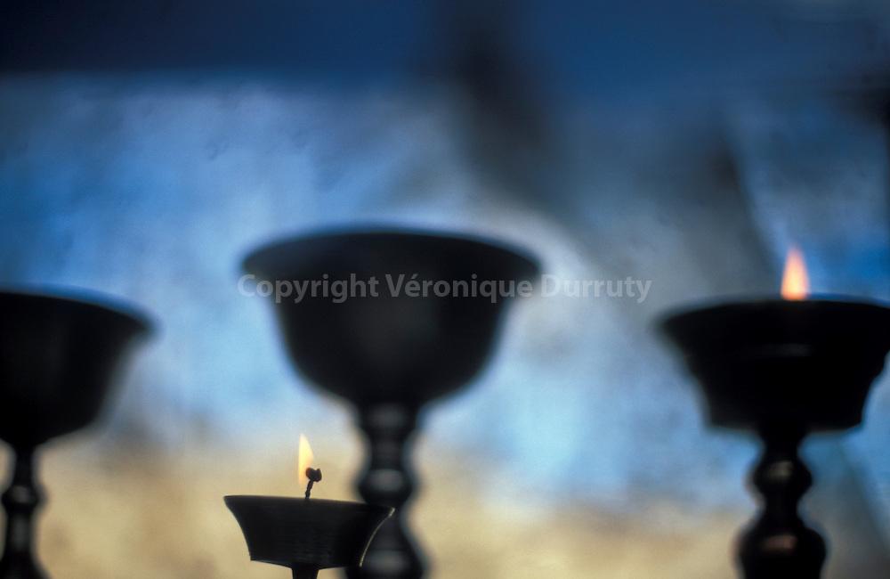 HOLY LAMPS, SHANTI STUPA. CHANGSPA. LEH, LADAKH, INDIA // Lampes offrandes au beurre de yak, dégageant cette odeur de beurre rance fondu, caracteristique des temples que lon reterouve dans tout le monde du bouddhisme tibétain...