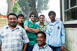 I focus on the other trainees—on Prabin's Italia jersey, on Karma's Converse sneakers, on Sanjay's button-down shirt so neatly tucked in. Though they bear crude-looking tattoos of Batman symbol and cannabis leaf, there are no track marks or hollowed-out eyes. Though I know they're over thirty, they barely seem to have aged past eighteen. They look more like hip IT graduates than men who have spent half their lives injecting drugs into their veins.