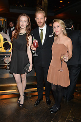 Left to right, OLIVIA GRANT, ALISTAIR GUY and ALEXANDRA BERG at the OMEGA VIP dinner hosted by Cindy Crawford and OMEGA President Mr. Stephen Urquhart held at aqua shard', Level 31, The Shard, 31 St Thomas Street, London, SE1 9RY on 10th December 2014.