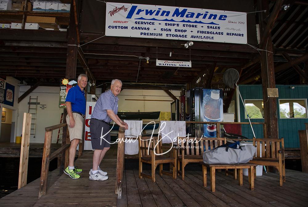 Bill and Jack Irwin on the docks at Irwin Marine looking out to Paugus Bay, Lake Winnipesaukee.  (Karen Bobotas for New England Boating Magazine)