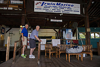 Bill and Jack Irwin on the docks at Irwin Marine looking out to Paugus Bay, Lake Winnipesaukee.  (Karen Bobotas for New England Boating Magazine)