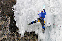 A young man climbs ice in Hyalite Canyon near Bozeman, Montana.