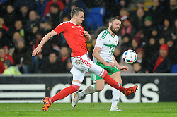 Stuart Dallas of Northern Ireland crosses the ball under pressure from Chris Gunter of Wales - Mandatory by-line: Dougie Allward/JMP - Mobile: 07966 386802 - 24/03/2016 - FOOTBALL - Cardiff City Stadium - Cardiff, Wales - Wales v Northern Ireland - Vauxhall International Friendly