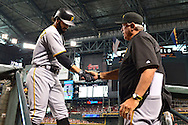 Apr 23, 2016; Phoenix, AZ, USA; Pittsburgh Pirates infielder Sean Rodriguez (3) is congratulated by manager Clint Hurdle (13) after hitting a solo home run in the second inning against the Arizona Diamondbacks at Chase Field. Mandatory Credit: Jennifer Stewart-USA TODAY Sports