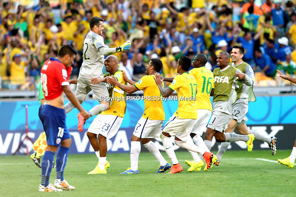 Fifa Soccer World Cup - Brazil 2014 - <br /> BRAZIL (BRA) Vs. CHILE  (CHI) - Round of 16 - Estadio Mineirao Belo Horizonte - Brazil (BRA) - 28 Jun 2014 <br /> Here Brazilian GK Julio Cesar receiving the congratulation of jis team maters after the last penalty to give to Brazil the match<br /> From L to R = Chilean Gonzalo JARA (Who lost the penalty) - Julio Cesar - Maicon - Hulk - Luiz Gustavo - Ramires - GK Jefferson and GK Victor<br /> © PikoPress