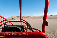 Miles of sand dunes surround the oasis village of Huacachina which has become a launching point for dune-buggy rides.