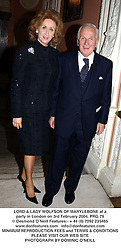 LORD & LADY WOLFSON OF MARYLEBONE at a party in London on 3rd February 2004.PRG 79
