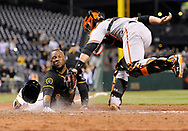 PITTSBURGH, PA - MAY 6:  Starling Marte #6 of the Pittsburgh Pirates slides safely into home plate to score the game winning run in front of Buster Posey #28 during the ninth inning of the San Francisco Giants on May 6, 2014 at PNC Park in Pittsburgh, Pennsylvania.  (Photo by Joe Sargent/Getty Images) *** Local Caption ***Starling Marte;Buster Posey