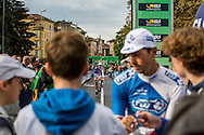 FDJ team members sign autographs before the start of Il Lombardia 2015 Bergamo - Como