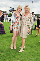 Left to right, EMERALD FENNELL and her mother LOUISE FENNELL at the 25th annual Cartier International Polo held at Guards Polo Club, Great Windsor Park, Berkshire on 26th July 2009.