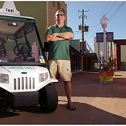 "Randall ""Rando"" Purdy(cq) poses for a portrait with his golf cart he converted into a taxi cab on the boardwalk at Carolina Beach. The golf cart taxi service is the first in North Carolina. (Jason A. Frizzelle) This collection of images illustrates a variety of portraits from headshots to location portraits. This collection of images represents more than a decade of work at newspapers and wire services throughout North Carolina. I now practice my style of story-telling photography for weddings community events as well as portrait sessions ranging from brides to local authors. After graduating from Randolph Community College I spent more than a decade documenting communities throughout Eastern North Carolina with a camera. My passion for capturing story-telling images has allowed me to witness everything from High School Football to Hurricanes and even Presidential visits.<br />