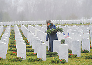 Sharon Brass of Hatboro, Pennsylvania looks for her mother-in-laws gravesite to place a wreath there during Wreaths Across America Saturday, December 14, 2019 at Washington Crossing National Cemetery in Newtown, Pennsylvania. Thousands of wreaths are laid each year for Wreaths Across America by volunteers who gather and then place the wreaths at graves of veterans. (Photo by William Thomas Cain / CAIN IMAGES)