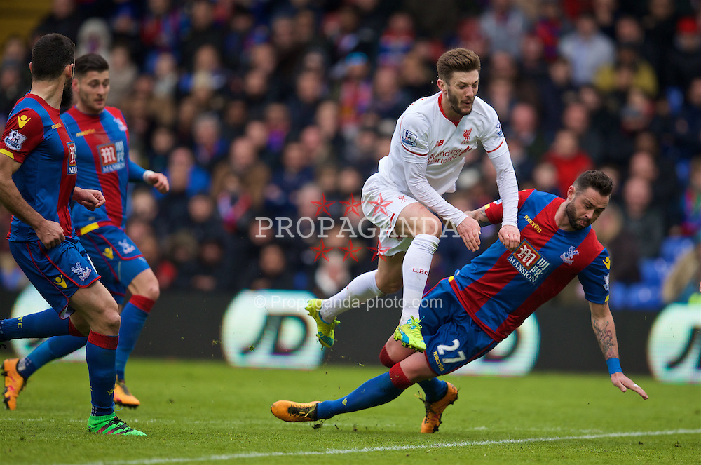 LONDON, ENGLAND - Sunday, March 6, 2016: Liverpool's Adam Lallana is tackled by Crystal Palace's Damien Delaney during the Premier League match at Selhurst Park. (Pic by David Rawcliffe/Propaganda)