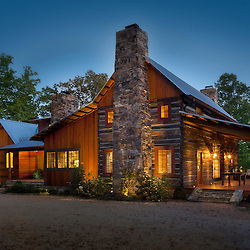 exterior photo of log cabin at dusk