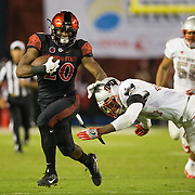 08 October 2016: The San Diego State Aztecs football team open's up the mountain west conference season at home against the University of Nevada Las Vegas Lobos. San Diego State running back Rashaad Penny (20) rushes the ball for a first down in the second quarter. The Aztecs lead the Lobos 13-7 at halftime. www.sdsuaztecphotos.com