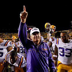 November 10, 2012; Baton Rouge, LA, USA; LSU Tigers head coach Les Miles celebrates a win over the Mississippi State Bulldogs after a game at Tiger Stadium.  LSU defeated Mississippi State 37-17. Mandatory Credit: Derick E. Hingle-US PRESSWIRE