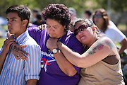 Trina Besler, center, is comforted by her son Robert Besler and Michelle Irby during the opening ceremony of her 7th Relay For Life at the Milpitas Sports Center in Milpitas, California, on June 22, 2013. Trina's husband, Daniel Besler, passed away last year after losing a battle with cancer. (Stan Olszewski/SOSKIphoto)