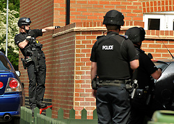 © licensed to London News Pictures. Norwich, UK  06/05/2011. Police at a house in Norwich today (06 May 2011). A man is believed to be holding a woman hostage inside the residence. The woman briefly appeared at a window of the property and spoke to police officers. A number of armed police officers and a police helicopter are at the scene. Please see special instructions for usage rates. Photo credit should read Alan Bennett/LNP