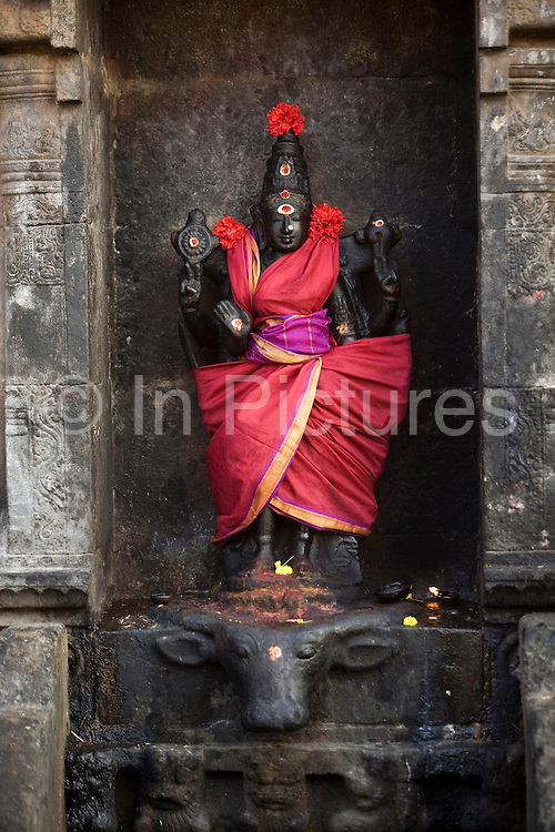 A dressed Chola period idol that has been worshipped at the Airatesvara Temple in Dharasuram, Kumbakonam, Tamil Nadu, India.The temple, constructed by Rajaraja II (r 1146-63) is a superb example of twelfth century Chola architecture and it's art depicts Shive in the rare incarnation as Kankalamurti, the mendicant