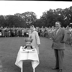 HM The Queen Elizabeth II with 3rd Viscount Cowdray at the Cowdray Gold Cup Polo, Cowdray Park, Midhurst, Sussex on 10th July 1960.