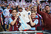 Young Aston Villa fans with a replica FA Cup during the The FA Cup match between Arsenal and Aston Villa at Wembley Stadium, London, England on 30 May 2015. Photo by Phil Duncan.