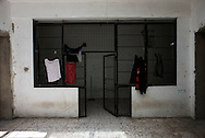 Libya, Tripoli: Drying clothes of migrant hanging inside Abu Salim detention center for illegal migrants. Alessio Romenzi