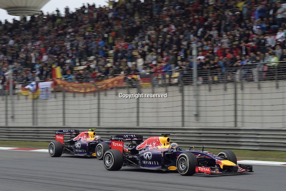 20.04.2014. SHanghai, China.  Motorsports: FIA Formula One World Championship 2014, Grand Prix of China, 1 Sebastian Vettel (GER, Infiniti Red Bull Racing), 3 Daniel Ricciardo (AUS, Infiniti Red Bull Racing)