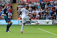 Swansea city's Wayne Routledge shoots and scores his sides 1st goal. Barclays Premier league, Swansea city v Sunderland at the Liberty Stadium in Swansea, South Wales on Saturday 1st Sept 2012. pic by Andrew Orchard, Andrew Orchard sports photography,