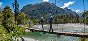Doppelgangers on the last swing bridge of the Hollyford Track, at Hollyford Road End, in Fiordland National Park, Southland region, South Island of New Zealand. This image was stitched from multiple overlapping photos.
