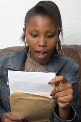 Teenage girl opening exam results,