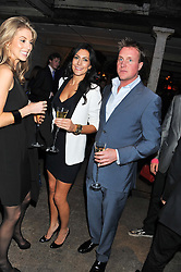 LOUISE COLE and HENRY BECKWITH at a party to celebrate the launch of the new Vertu Constellation phone - the luxury phonemakers first touchscreen handset, held at the Farmiloe Building, St.John Street, Clarkenwell, London on 24th November 2011.