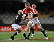 Simon Shaw of the Lions trying to run over Guy Cronje of the Sharks.<br /> Rugby - 090610 - British&Irish Lions v Sharks - ABSA Stadium - Durban - South Africa. The Lions won 37 -3.<br /> Photographer : Anton de Villiers / SASPA